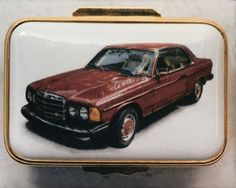 Red Mercedes - Enamel Miniature Painting by Mark D Morris. Commissioned miniature painting onto an enamel box lid of a red Mercedes. This was a commission for Halcyon Days onto one of their medium size rectangular boxes. I really enjoy painting cars, the reflections on the car body really make it come alive! Actual painting size is 64mm x 43mm. © MDMorris.