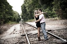 southern style engagement session by the railroad tracks