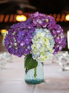 We collected light blue Ball jars from my Great Aunt and Grandmothers and filled with purple and blue hydrangeas