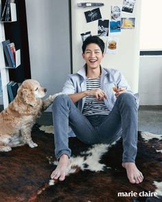 Song Joong Ki cuddles with an adorable puppy for Marie Claire