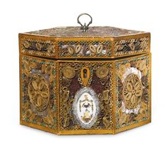 A George III parcel-gilt and polychrome painted rolled paper and fruitwood hexagonal form tea caddy circa 1775