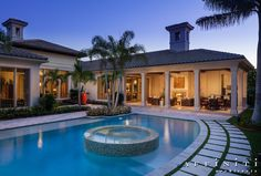 Symmetrical Transitional Mediterranean. his 5,837 s.f. one-story residence features an open plan designed for empty-nester country club entertaining.