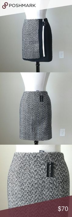 Gray tweed mix boot skirt -Fully lined -Side zip -Shell: 53% polyester,  34% acrylic,  6% wool, 7% other fibers -Shell solid fabric: 82% polyester,  12% rayon,  6% spandex -Waist 38 inches, hip 45.5 inches, length 18 inches White House Black Market Skirts Mini