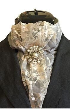 Rock House Couture Custom Dressage Stock Tie. I will create a custom stock tie especially for you to match your show colors and horse.  I design for dressage, eventing, hunters, equitation and jumping. All my ties are one of a kind, hand made with the highest quality materials. Visit my website for details.
