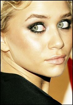black rimmed eyes with green gray shadow