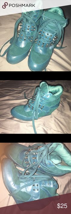 Teal spiked tie-up Wedge Sneaker Stylish wedged sneaker with spikes (velcro attachments ), set off your summer or back to school with these cute shoes! Gently used, 3 1/2 inch wedge ; drawstring mesh holder included Privileged Shoes Sneakers