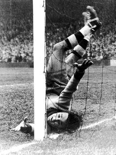 Racing Club goalkeeper Landi almost poleaxes himself while making a save against Arsenal in a pre-season friendly, 1948