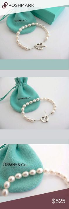 Tiffany & Co pearl Open Heart toggle bracelet Simple, evocative shape of Elsa Peretti Open Heart designs celebrates the spirit of love. Elegant pearls pair perfectly with the delicate heart toggle closure.  Worn twice.  In excellent condition.  No box. Silver ring from the same collection is also for sale. Still available on website for $725 plus S&H. Don't miss this great deal. Tiffany & Co. Jewelry Bracelets
