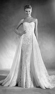 Get two wedding dresses in one with this intricate lace wedding dress that comes with an beautiful overskirt that provides an extra touch of elegance. Available at Schaffer's in Des Moines.  Dress Info: Atelier Pronovias - STYLE EDITH