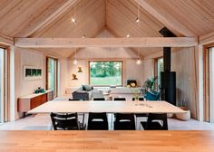 MNy Arkitekter uses seven types of timber for Finnish lake house Modern Wooden House, Modern Lake House, Helsinki, Types Of Timber, Freestanding Fireplace, Building A House, Living Spaces, House Plans, Tiny House