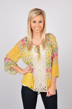 Everyone will be BEGGING to take you to brunch in our Take Me To Brunch Top! This top has a lace design down the front middle, and features an Aztec design throughout. This sheer top is sure to be a jaw-dropper! This top is made out of 100% Polyester. Dry clean only.