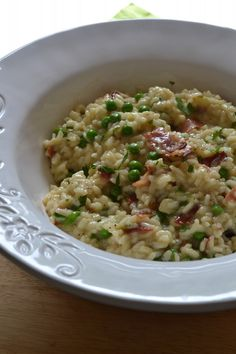 Creamy Risotto Carbonara with peas, crisp prosciutto, and lots of pecorino romano cheese
