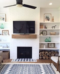 I love this super simple fireplace, mantle and shelves combo. Do you just love it? I am thinking about adding some floating shelves to our living room! I feel like this is good inspiration! Design by...