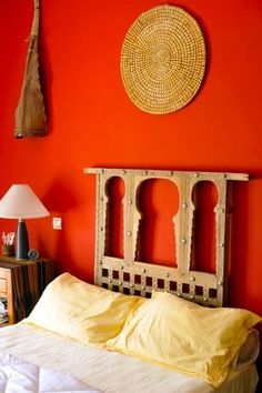 Moroccan decor: An old Moroccan window as a headboard. Walls painted in a warm Moroccan red. love the headboard so much! Decor, Moroccan Decor, Yellow Bedroom, Interior, Red Rooms, Bedroom Decor, Pink Room, Home Decor, Pink Houses