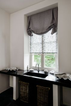 Try Tulip Roman Shades for a decorative touch in the powder room. Shown in material Herringbone, color Toast. | The Shade Store