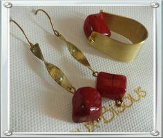 Orecchini mod. Twist e anello mod. U-ring, in ottone riciclato e corallo bambù rosso.