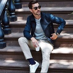 This combo of a navy blue bomber jacket and cream chinos will enable you to keep your off-duty style clean and simple. Round off this look with white plimsolls.   Shop this look on Lookastic: https://lookastic.com/men/looks/bomber-jacket-crew-neck-t-shirt-chinos-plimsolls-sunglasses-watch-socks/12652   — Black Sunglasses  — Grey Crew-neck T-shirt  — Navy Bomber Jacket  — Navy Rubber Watch  — Beige Chinos  — Navy Polka Dot Socks  — White Plimsolls