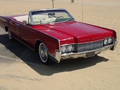1967 Lincoln Continental Convertible. What more can you say its a 4-door, suicide doors, convertible. Awesome!