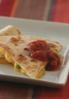 Cheesy Quesadillas — You might make these Cheesy Quesadillas for the vegetarians at your party, but be forewarned: The carnivores will be going after them too!