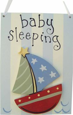 This darling baby sleeping doorhanger is the perfect little reminder to family members to keep things quiet while baby naps. Each wooden doorhanger is handpainted and hangs by a white satin ribbon. It
