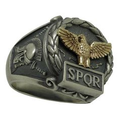 Exquisitely Handcrafted Sterling Silver 925 and Yellow Gold 10K Custom Made Roman Empire Eagle SPQR Ring with intricately detailed frame and antique/rustic finish . DISCRIPTION: . Made From: Sterling Silver 925 + Yellow Gold 10K . Metal Purity: .925 / 10K . WEIGHT: 17 to 19 grams of