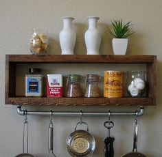 Handmade spice rack with pot rack. Perfect for any home kitchen, apartment, or condo loft. It has been sanded down, then stained and sealed with a