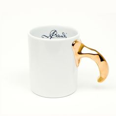 Model AN 01, White porcelain mug with gold , glossy finish.