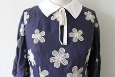 Vintage 60's secretary dolly-lolita, navy and white embroidered novelty floral peter pan bow collar dress. $98.00, via Etsy.