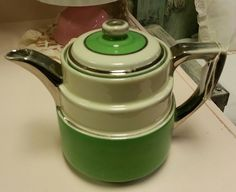 Very Old Vintage Pottery Tea Pot, Green, Cream and Silver. $40.00, via Etsy.