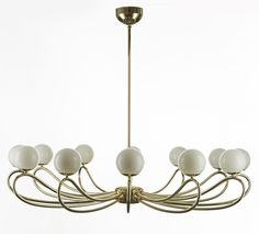 PAPILLON from MMLampadari. Fluid shape of metal pipes tailor-made of this chandelier want to remind the papillon, accessory of classic outfit, symbol of elegance and icon of style. Thanks to an expert craftsmanship has toke life to these chandeliers of rare quality. Papillon is available in glossy copper and opaque black.