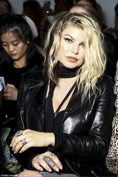 Leather lady: Fergie was channelling the rock chick look at London Fashion week on Saturday as she reunited with her former band mate Will I Am