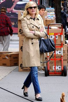 Icons in: The Trench.. a series!  Kirsten Dunst rocks hers with jeans and loafers. Chic and timeless