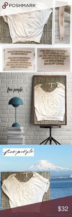 Free people Lace and embroidered top Beautiful and delicate top with lace embellished with a tonal embroidered floral design and a round neckline Low back with adjustable tie Smocked elastic waistband 100% Cotton Cropped silhouette  Previously owned and in very good condition. Colors may vary due to lighting.  💐Bundle & Save💰 Thanks for shopping my closet💕💕 Free People Tops Blouses