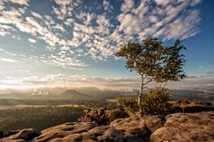 the view from Mount Gohrisch in the Saxon Switzerland at sunset. In the background you can see the Mount Lilienstein