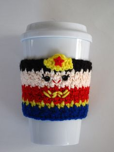 Free Crochet Wonder Woman Coffee Cup Cozy Pattern at The Enchanted Ladybug. Crochet Coffee Cozy, Coffee Cup Cozy, Crochet Cozy, Crochet Gifts, Diy Crochet, Crochet Ideas, Crochet Things, Coffee Mugs, Yarn Projects