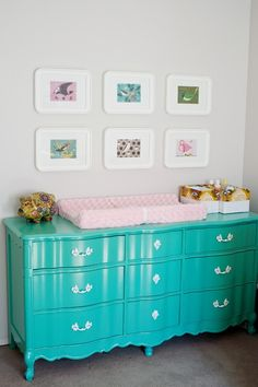 Super cute nursery space - aqua drawers round cornered frames - lovely :)