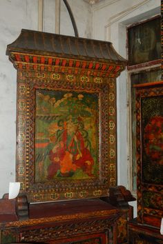 Hand painted pine wood thangka on stand from Tibet, China