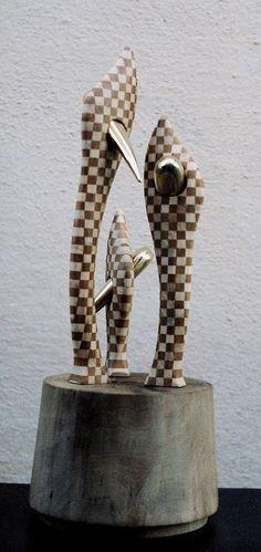 Wood sculpture with bronze.Dance buds, cherry, maple, walnut and bronze. https://www.facebook.com/jichici.mircea https://www.facebook.com/pages/Mircea-Jichici-painting/284399895040599 http://www.youtube.com/user/MrJichici