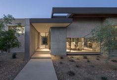 In a neighborhood of sprawling suburban houses on turf-covered lots, this residence at the end of a cul-de-sac is at home in its desert landscape.