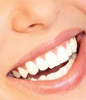 Homemade teeth whitening.   5 drops of Hydrogen Peroxide  1 tablespoon of Baking Soda