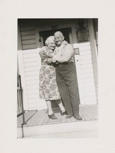 Affectionate elderly couple hugs on the porch by simpleinsomnia, via Flickr
