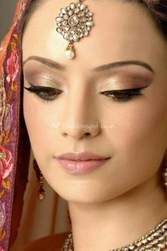Highlighting and contouring, eyes in warm golden and brown, strong upper liner, smoke smudged under liner, natural lip.