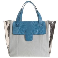 Marc Jacobs. If a canvas tote isn't quite your thing, there's always python.