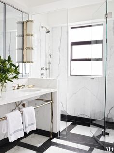 The master bath features a sconce by Ralph Lauren Home and nickel-plated shower and sink fittings by Dornbracht.