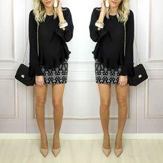 Combinação mais do que perfeita: blusa elegante com babados e saia estampada.  Peças disponíveis para compra no site http://ift.tt/PYA077.