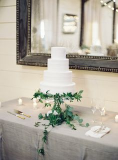 Wedding Cakes : Picture Description All white four tier wedding cake wrapped in olive branches and eucalyptus: www.stylemepretty… Photography: Allison Kuhn – www. All White Wedding, Mr And Mrs Wedding, White Wedding Cakes, Greek Wedding, Purple Wedding, Wedding Trends, Wedding Styles, Wedding Ideas, Wedding Venues In Virginia