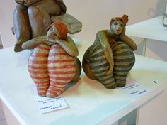 Ceramic figures with stripey stockings - who by though?