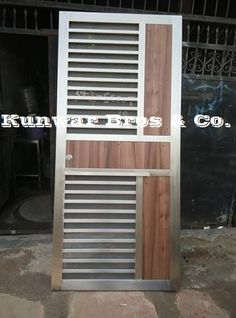 View in theatre mode Wooden Front Door Design, Main Entrance Door Design, Front Gate Design, Main Gate Design, House Gate Design, Door Gate Design, Steel Railing Design, Balcony Railing Design, Grill Gate Design