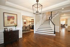 Pyle I Castlewood Custom Interior--classic, timeless design #Castlewood #Customhome #Architecture #foyer #interior #interiorhallways #hallways #design #homes #home #dreamhome #dreamspace #lighting