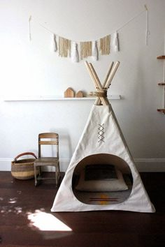 I love the round opening in this teepee (tipi). Simple and a perfect nook for the playroom. #openingadaycare